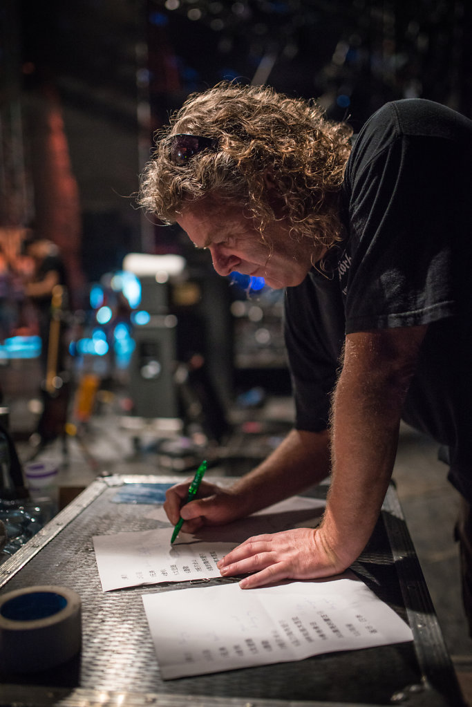 Day 3: Backstage Hanggai's tour manager writing down Hanggai's setlist.