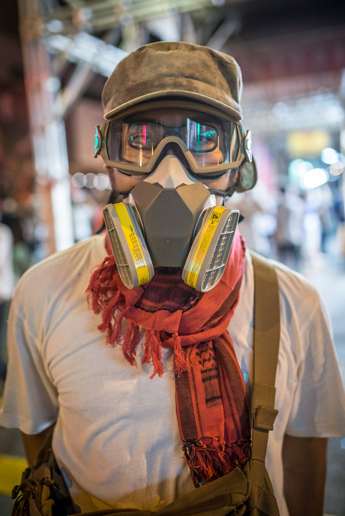 Protester wearing a gasmask