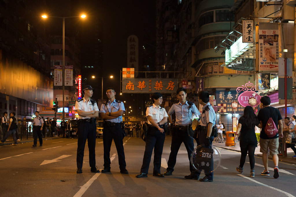 Police officers stand by close to the occupied streets