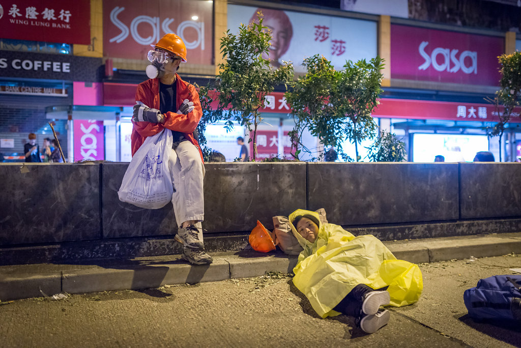 A couple ready to spend the night in an occupied street