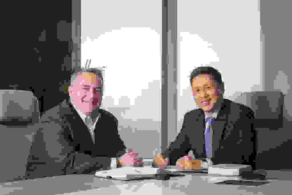 VMWare CEO Bernard Kwok (right) with a collaborator